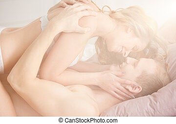 Lovers during erotic foreplay - Young romantic lovers in...