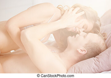 Couple touching in bed - Love and passion between intimate...