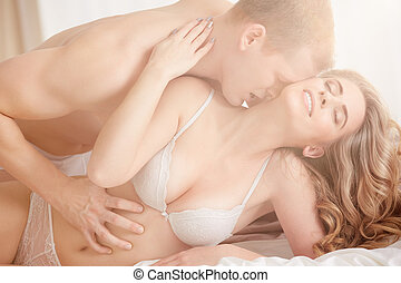 Man touching woman's belly - Young muscular man touching hot...