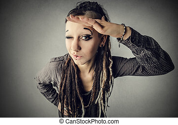Woman with dreadlocks looking into camera
