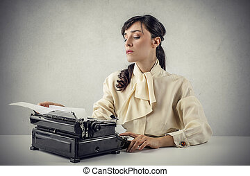 Woman with typewriter - Brunette woman with typewriter