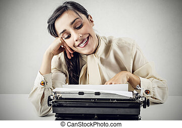 Woman typing with typewriter