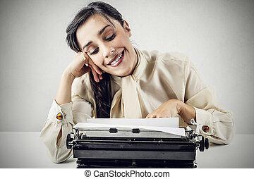 Woman typing with typewriter