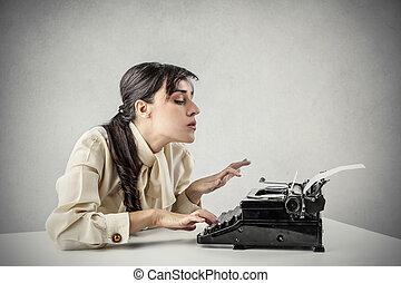 Woman with typewriter - Woman working on typewriter