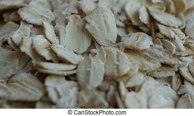 Oatmeal. Oat flakes. Close-up rotating.