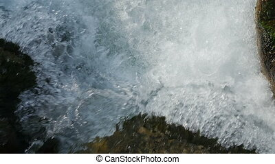 Slow motion of clean flowing water on the stones