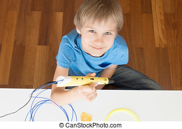 Child with 3D printing pen. - Boy with 3D printing pen. Top...