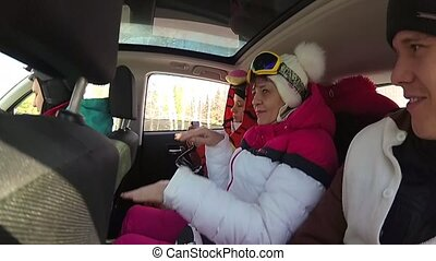 group skier having fun with the music in the car on the trip...