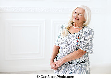 well-groomed old woman - Beautiful senior woman spending...