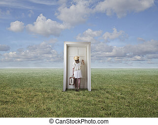 Woman in front of door on countryside
