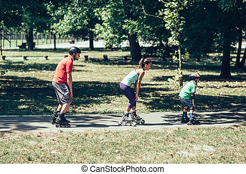 Family roller skating in a raw