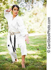 Asian practicing karate - A shot of an asian woman...