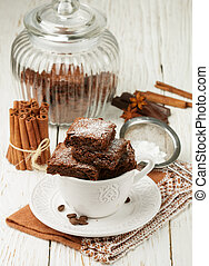 Squares brownie in a white Cup. Chocolate dessert....