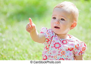 Baby girl outdoor - Baby girl spending time outdoor on a...