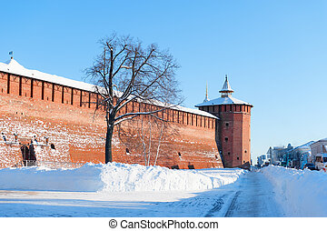 The Kremlin wall in the historic centre of red brick snowy winter horizontal layout