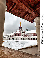Art the new Jerusalem monastery Istra, Russia wall and the road to the bell tower in winter