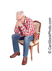 Senior man sitting and thinking. - A image of a white hair...