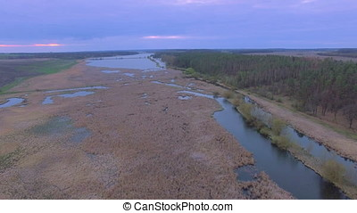 Aerial shot of the River gap at sunrise near swamp