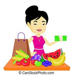 Woman standing at the table with shopping bag. - Asian...