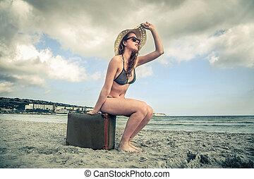 Woman on luggage - Woman in bikini sitting on luggage