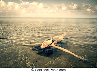 Woman in water - Woman floating in water
