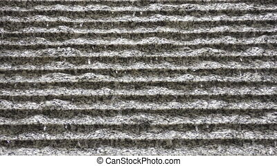A modern fountain. Water flows down the wall.