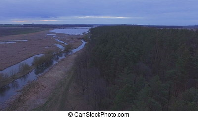 Aerial shot of the River gap at sunset near swamp and forest