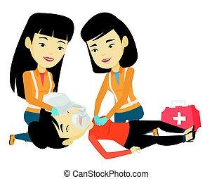 Paramedics doing cardiopulmonary resuscitation. - Asian...