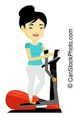 Woman exercising on elliptical trainer. - Asian woman...