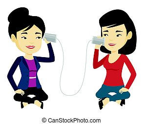 Young friends talking through tin phone. - Women discussing...