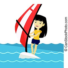 Young woman windsurfing in the sea. - Asian woman...