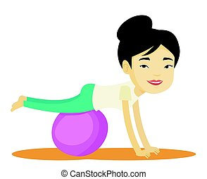Young woman exercising with fitball. - Asian woman...