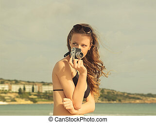 Woman with camera - Woman in bikini with camera
