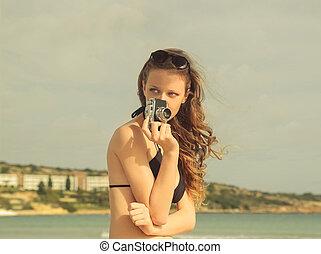 Woman with camera - Woman in bikini with camera