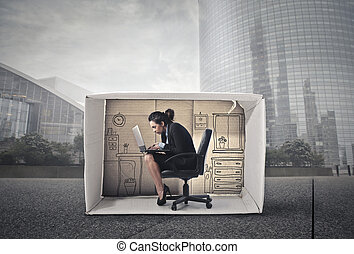 Business woman in box - Business woman sitting in box