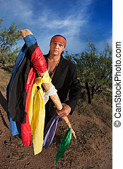 Native American man with colorful flags representing seven...