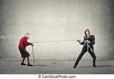 Man pulling old lady with rope