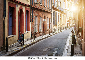 Sunlight in Toulouse - Warm sunlight on narrow street in old...