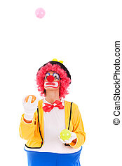funny clown juggling with color balls (isolated on white)
