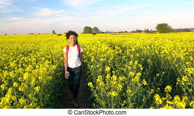 African American girl teenager female young woman hiking...