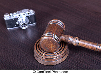 auction hammer , symbol of authority and vintage camera.