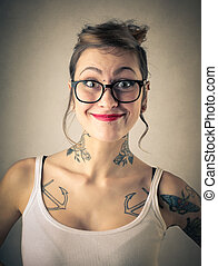 Smiling woman with tattooes