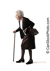 Lady in studio - Older lady walking with stick
