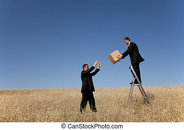 Business delivery process - businessman in a step ladder...