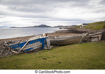 Rowing boats on shore, Wester Ross, Highlands, Scotland