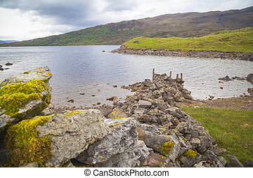 Stones at the shore of Loch Assynt, Highlands, Lairg,...