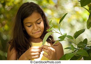 young child enjoying nature - young happy female child...