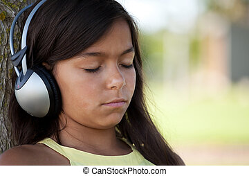 young child listening music