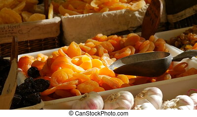 Dried apricot fruit on heap at marketplace.