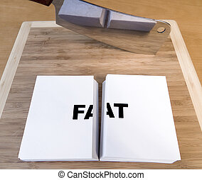 Cutting Fat - Cutting fat with a cleaver and cutting board.